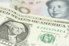 Currency wars. The American dollar against the Chinese yuan royalty free stock photos