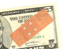 Currency weakness. Adhesive bandage on a banknote as symbol for the weakness of a currency Royalty Free Stock Photography