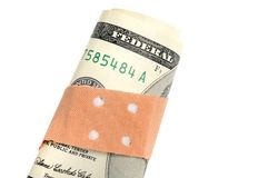 Currency weakness. Adhesive bandage on a banknote as symbol for the weakness of a currency Stock Photo