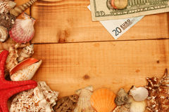 Currency on wood Royalty Free Stock Photography