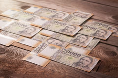Currency on wooden table Royalty Free Stock Images
