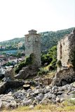 Belfry in the old fortress with a clock, the remains of walls, stones and ruins, Bar, Montenegro. stock photo