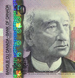 Current Canadian $10 Banknote. This $10 Canadian banknote is the current circulating bill and was issued in 2005 Stock Photos