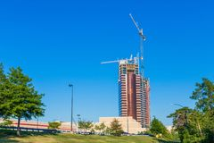 Cranes and current construction of Encore Boston Harbor restort casino, view from Mystic River royalty free stock image