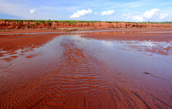 Current Flowing on Red Sand Royalty Free Stock Photography