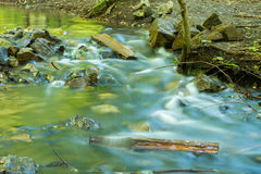 Current forest creek water, taken with long exposure Royalty Free Stock Photos
