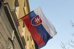 Flag of Slovakia. The current form of the national flag of Slovakia was adopted by Slovakia`s Constitution, which came into force on 3 September 1992. The flag royalty free stock photography