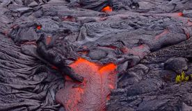Current lava on the surface of the earth. Liquid lava stock photo