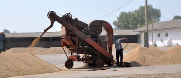 On the current mobile grain cleaning machine Stock Photos