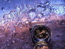 Current of time. Stream of water above hours Royalty Free Stock Image