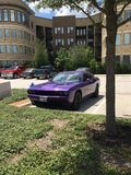 A current version Dodge Challenger in Plum Crazy Purple in an apartment parking lot royalty free stock photos