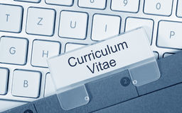 Curriculum Vitae - folder with text on computer keyboard. In the office stock photo