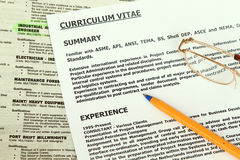 Curriculum Vitae  Form. Beside classified ads with engineer highlighted Stock Images