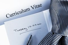 Curriculum Vitae Appointment and Tie. Curriculum Vitae with an interview appointment and a tie stock photo