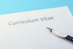 Curriculum vitae written on an blank white paper Royalty Free Stock Photo