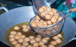 Curried fish cake. Frying of Curried fish cake stock photos