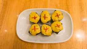 Curried fish wrapped in top view. Thai tradition food; curried fish wrapped in banana leaves and steamed Stock Photo
