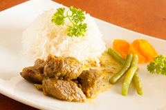 Curried Goat served with white rice, string beans and sliced carrots royalty free stock photo