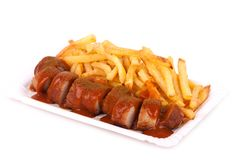 Curried sausage and chips Royalty Free Stock Photo