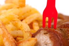 Curried sausage and chips Stock Photo
