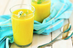Curried Zucchini Cream Soup in Tall Glasses Stock Photo