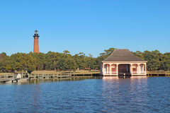 The Currituck Beach Lighthouse and boathouse near Corolla, North. The red brick structure of the Currituck Beach Lighthouse and the pink boathouse at Currituck Stock Photo