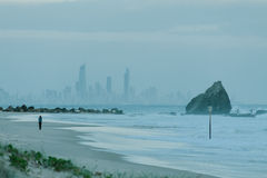 Currumbin rock with Gold Coast City as background Stock Image