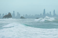 Currumbin rock with Gold Coast City as background Stock Images