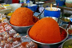 Curry in the bazaar, Spicy Curry pile, Curry red orange colorful spice market, Traditional spices hot food in local bazaar in Thai royalty free stock photography
