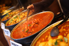 Curry being served. Indian food at Camden market Royalty Free Stock Images