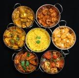 curry besegrar indier Fotografering för Bildbyråer