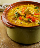 Curry in  bowl on a wooden table. Royalty Free Stock Photos
