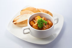 Curry Chicken with Bread. Isolated Curry Chicken with Bread in White Background Stock Image