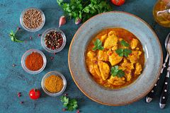 Curry with chicken and onions. Indian food. Asian cuisine. Royalty Free Stock Image