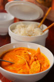 Curry chicken with rice served in bowl Stock Image