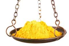 Curry dans une échelle d'équilibre images libres de droits