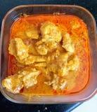 Curry del pollo del burro Immagini Stock