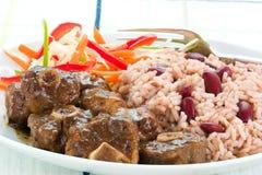 Curry della coda di bue con riso - Carib Immagini Stock