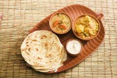 Curry di Masala della patata con la patata Paratha Fotografia Stock