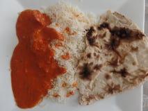 Curry di masala di tikka del pollo con il riso e il roti di pilaf Immagini Stock Libere da Diritti