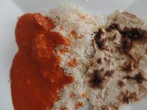 Curry di masala di tikka del pollo con il riso e il roti di pilaf Fotografia Stock