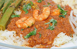 Curry Dinner. Meal of Prawn or shrimp curry with rice and okra Royalty Free Stock Photography