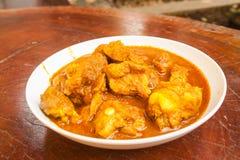 Curry för grisköttstöd Arkivfoto