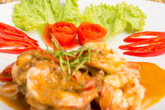 Curry fried shrimps and cooked rice Royalty Free Stock Photos