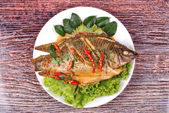 Curry-fried Tilapia fish with spicy topping. Royalty Free Stock Photography
