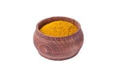 Curry giallo in vaso di legno Fotografie Stock