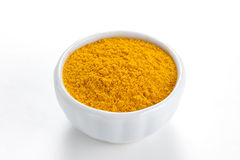 Curry ground in a white bowl on white background. stock image