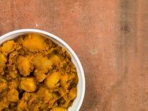 Curry indiano di Bombay Aloo di stile Immagine Stock