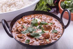 Curry in Karachi dish. Chicken masala curry in Karachi with coriander and rice Stock Photo