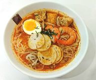 Curry Laksa traditional Spicy Noodles. In Singapore in Asia royalty free stock photo